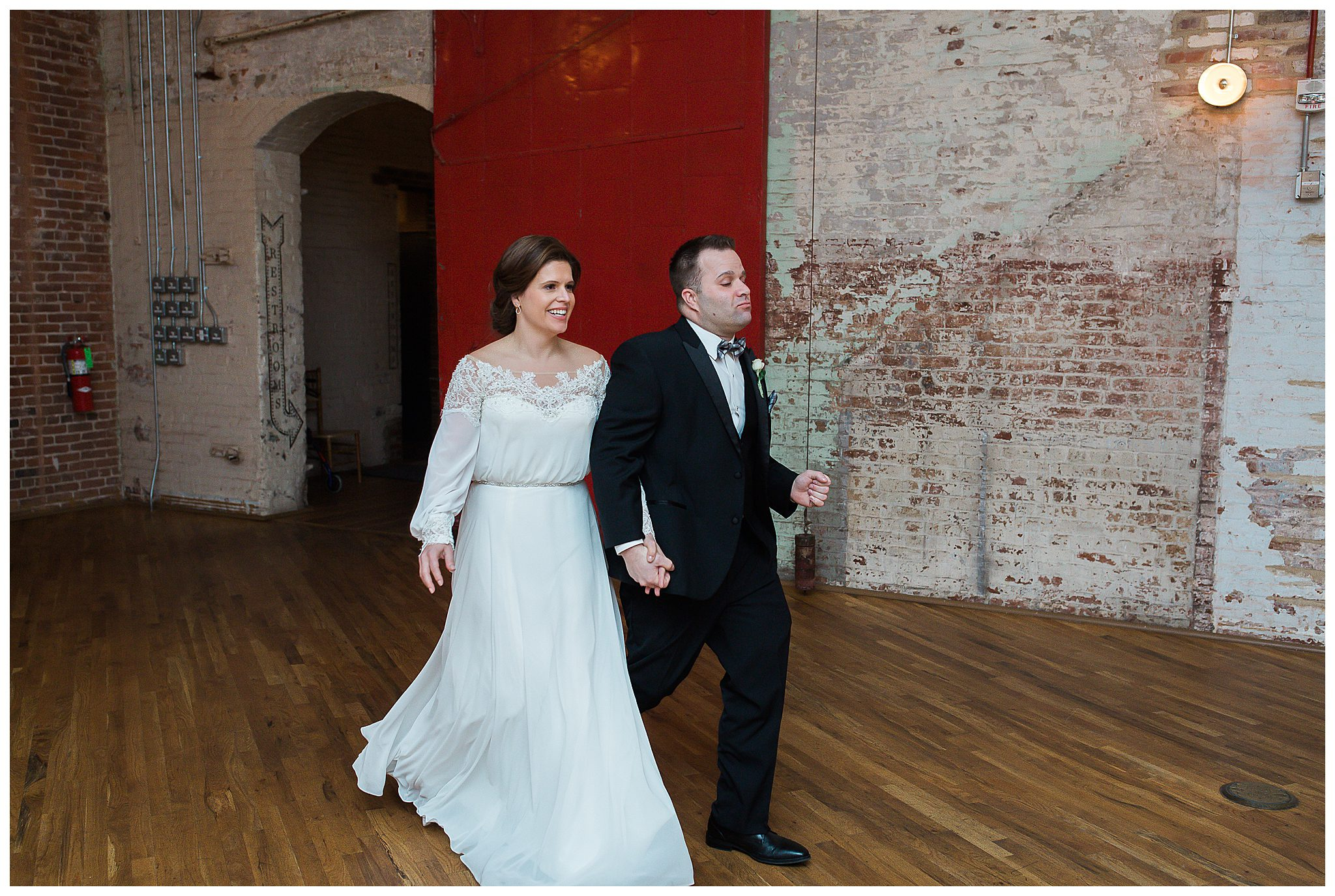 Couple introduction near red door at The Cedar Room Charleston SC